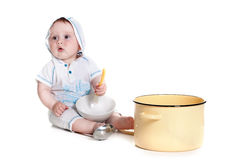 Little boy holding a spoon Stock Photography
