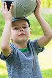 Little boy holding sport ball Royalty Free Stock Photography