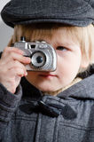 Little boy holding toy camera and taking photos Royalty Free Stock Image