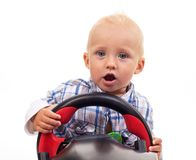 Little boy holding a toy steering wheel over white Stock Photography