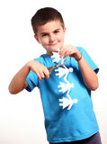 Little boy holding up paper chain and scissor Stock Images