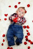 Little boy holding valentines heart Stock Photos