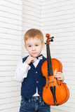 Little boy holding a violin Royalty Free Stock Photos