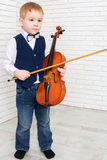 Little boy holding a violin Stock Photography