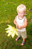 Little Boy Holding Water Lilly. A young child holding a Water Lilly stock photography