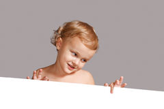 Little boy holding a white blank Royalty Free Stock Photo