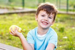 Little boy holding yellow pear Royalty Free Stock Images