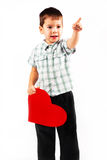 Little boy holds a big red heart. Little happy boy holds a big red heart holiday Valentine's Day Royalty Free Stock Photos
