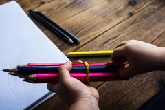 Little boy holds colored pencils royalty free stock photo
