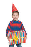 Little boy holds a gift box Stock Photo