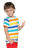 Little boy holds his thumb up and back Stock Photography