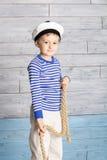 Little boy holds marine rope Stock Photos