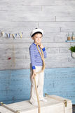 Little boy holds marine rope Royalty Free Stock Images