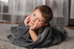 Little boy at home on the carpet Royalty Free Stock Image