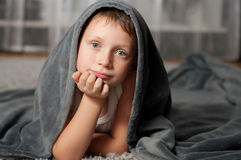 Little boy at home on the carpet Royalty Free Stock Photography