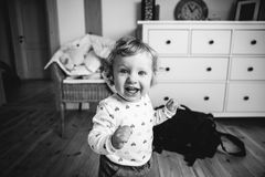 Little boy at home in his bedroom smiling. Cute little boy at home in his bedroom smiling royalty free stock photos