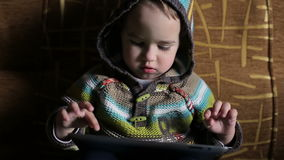 Little boy in hood browse tablet pc stock footage