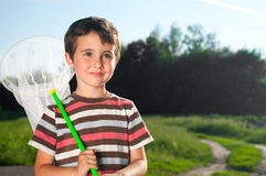 Little boy with hoop net outdoors Stock Images