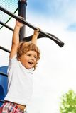 Little boy on horizontal bar Royalty Free Stock Image