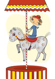 A little Boy on a Horse Carousel Stock Photos