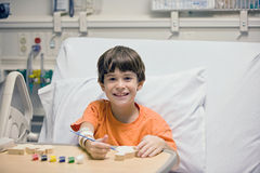Little Boy in Hospital. Little Boy Painting in the Hospital