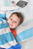 Little boy in a hospital bed Royalty Free Stock Image