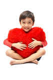 Little boy hug pillow heart Royalty Free Stock Photo
