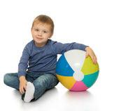 Little boy hugging the ball stock images