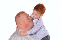 Little Boy Hugging Dad. Young redheaded boy hugging his father Stock Photography