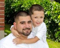 Little boy hugging dad Stock Image
