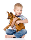 Little boy hugging a dog. isolated on white background Stock Photos