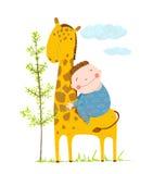 Little boy hugging a giraffe Stock Images