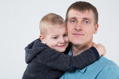 Little boy hugging his father. Closeup photo in studio Royalty Free Stock Images
