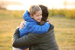 Little boy hugging his father. Outdoors Royalty Free Stock Photo