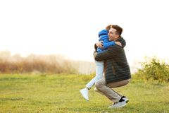 Little boy hugging his father. Outdoors Royalty Free Stock Images