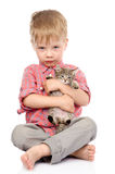 Little boy hugging a kitten.  on white background Royalty Free Stock Photos