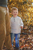 Little boy hugging the leg. His father in a park Royalty Free Stock Photo