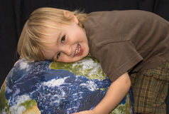Little Boy Hugging the Planet Royalty Free Stock Photo