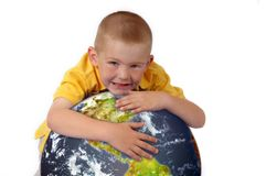 Little boy hugging planet earth Stock Photos