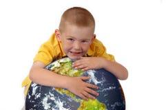 Little boy hugging planet earth Stock Photos