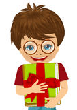 Little boy hugging a stack of books decorated with a red ribbon Stock Image