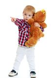 Little boy hugging a teddy bear. Stock Image