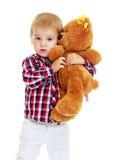 Little boy hugging a teddy bear Royalty Free Stock Photos