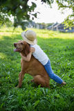 Little boy and Hungarian Vizsla. Outdoor portrait: Little boy and Hungarian Vizsla Stock Image