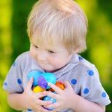 Little boy hunting for easter egg on Easter day Stock Photo