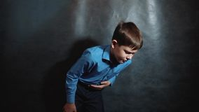 Little boy hurts his stomach. Young blond European German businessman gastritis disease ulcer bad unhealthy food fast. Food schoolboy lifestyle. idea concept stock footage
