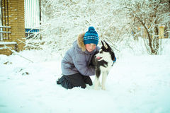 Little boy with Husky dog on  snow Stock Photos