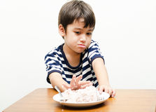 Little boy ignore  his meal time. Little boy ignore  his meal on the table Royalty Free Stock Photography