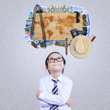 Little boy imagine famous vacation place. Portrait of cute little boy wearing glasses and looking up while imagine famous vacation place around the world Stock Photo