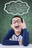 Little boy imagine his future jobs Stock Images